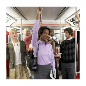 Business woman in a crowded subway train car needs natural immune system supporter
